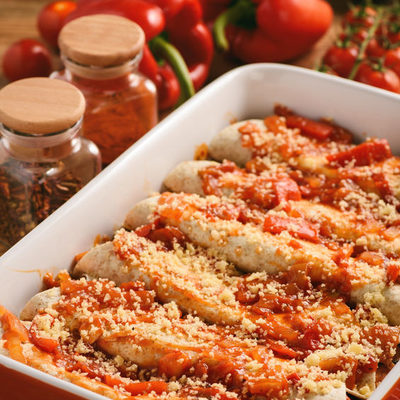 Enchiladas are a Mexican dish that consists of tortillas stuffed with meat, cheese, or beans and covered in a spicy sauce.