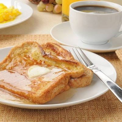 French toast is an age-old recipe that involves dipping bread in an egg-and-milk mixture then pan frying it.
