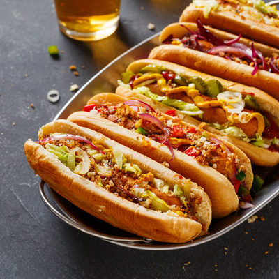 A hot dog is cured meat shaped in the form of a sausage, that is usually grilled or steamed.