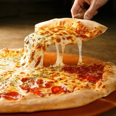 Pizza is a savory dish made of dough, sauce, toppings, and baked in an oven