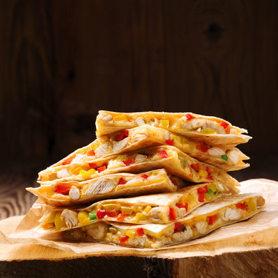 Quesadilla is a griddle-cooked stuffed tortilla that comes from Mexico