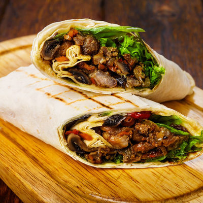 Burrito is a Mexican dish that consists of different ingredients and stuffing mixed and filled into a flour tortilla and rolled like a wrap.