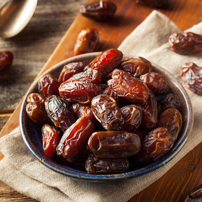 Dates are the edible fruit of the date palm tree, where they grow in clusters.