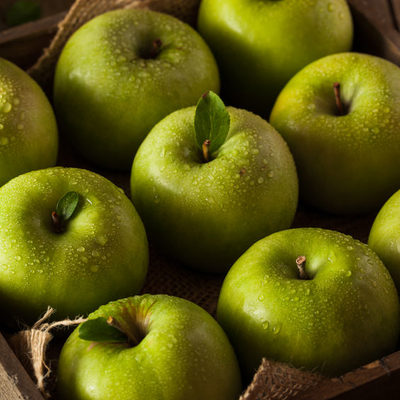 The green apple is a specific type of apple which is light green in color, with crisp and juicy flesh.