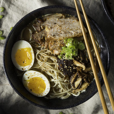 Ramen is a Japanese noodle soup served with a rich combination of flavorful broth, mix of meats and vegetables, and topped with a boiled egg.
