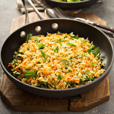 Fried rice is a hot dish that includes cooked rice, and depending on the recipe, eggs, meat, seafood, or vegetables.