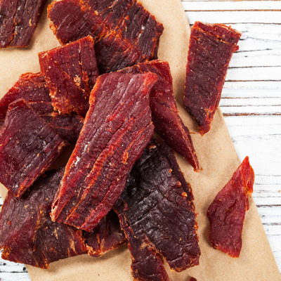 Jerky is a meat that has been cut into strips, cooked, and dehydrated in order to prevent spoilage.