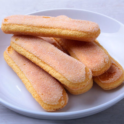 Ladyfingers are light, sweet, and spongy biscuits made from an egg base and shaped like fingers.