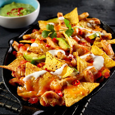 Nachos are a delicious dish that are sometimes served as an appetizer and typically consist of baked tortilla chips covered with melted cheese.