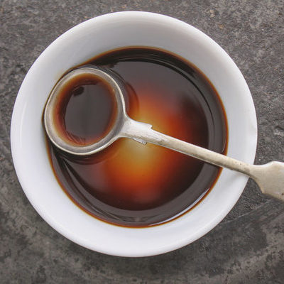Worcestershire sauce is a sauce made of different ingredients, including vinegar, fermented onions, fermented garlic, molasses, tamarind paste, cured anchovies, salt, and sugar.