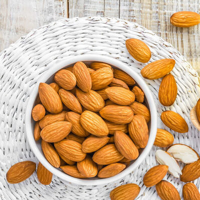 Almonds are the brown seeds of the fruit of the almond tree, which are considered drupes or stone fruits.