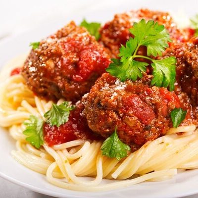 Spaghetti is a long, thin pasta with a cylindrical shape, commonly used in Italian cuisine.