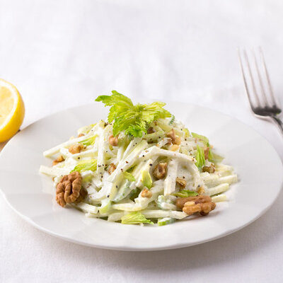 A Waldorf salad is a fresh salad made with fruits and nuts, including apples, grapes, walnuts, and celery.