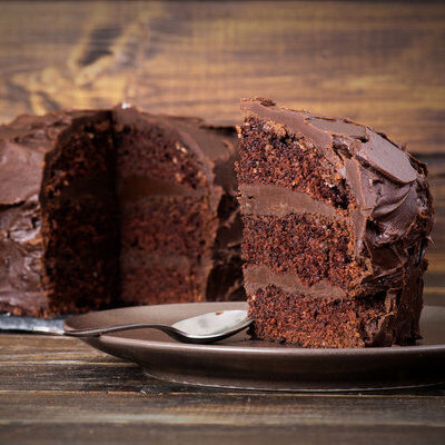 Devil's food cake is a rich, moist chocolate layer cake that is filled and topped with dark chocolate frosting.