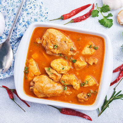Red curry is a food of Thai origin that consists of red curry paste cooked with coconut milk and other additional spices.