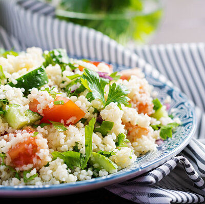 Tabbouleh is a salad of Arabic or Middle Eastern origin that is made with bulgur, garlic, parsley, mint, tomatoes, scallions, and onions.