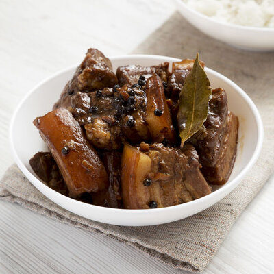 Humba is a Filipino pork-based dish that contains banana blossoms, salted black beans, pineapple juice, soy sauce, and brown sugar.