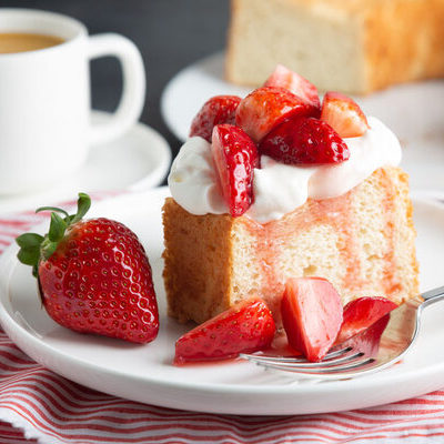 Angel food cake is a type of low-fat cake made with egg whites, flour, sugar, and cream of tartar. The cake is a sponge cake which uses no butter, differentiating it from most other cakes.