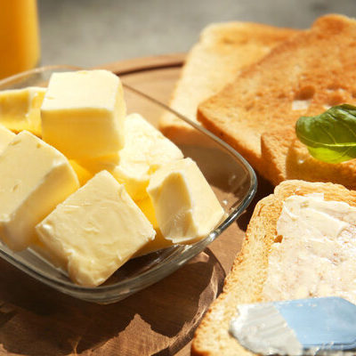 Butter is a dairy product made from the fats and proteins of milk, prepared by churning the cream of that milk, usually sourced from cows.