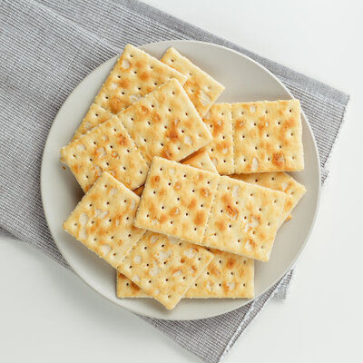 Crackers are flat baked goods made from flour, water, salt, sugar, and oil
