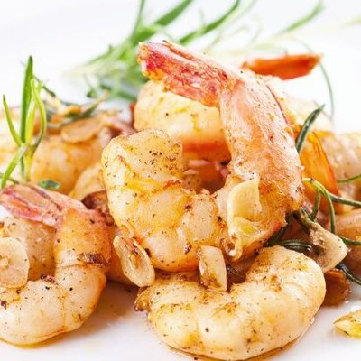 Shrimp are crustaceans with long bodies, tails, slender legs, and whiskers that belong to the Decapoda family.