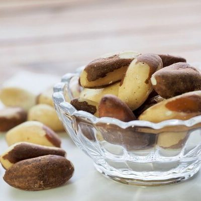 The Brazil nut (Bertholletia excelsa) is a brown, oval-shaped nut that belongs to the monkey pot tree (Lecythidaceae) family.