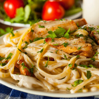 Fettuccine is a type of pasta that is shaped into long ribbons.