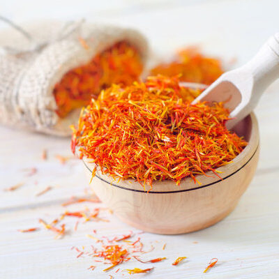 Saffron is a spice derived from the flower of the crocus sativus and is dried for use as a seasoning and coloring agent.
