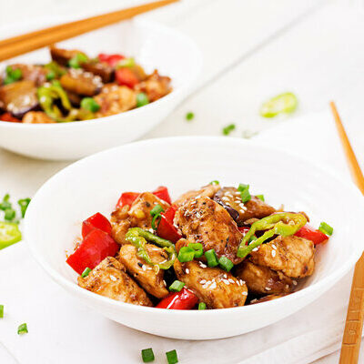 Kung Pao Chicken is a Chinese dish prepared with chicken, peanuts, vegetables, and chilies.